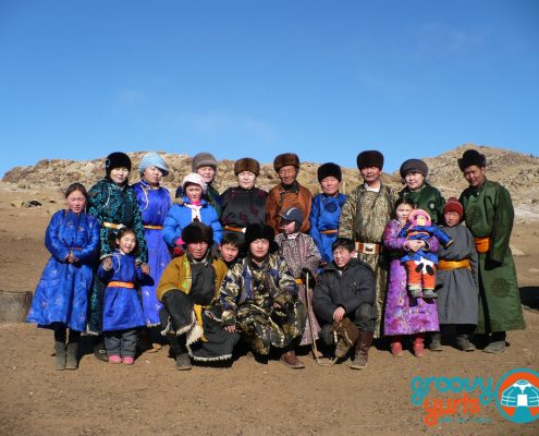 mongolian family posing for a picture
