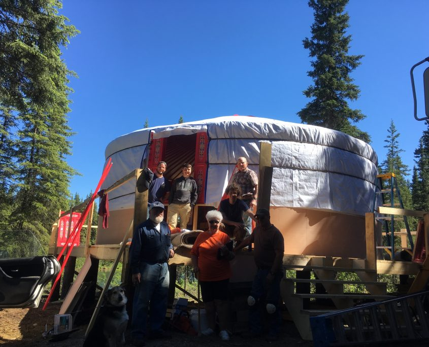a yurt installation being performed by the groovy yurts team
