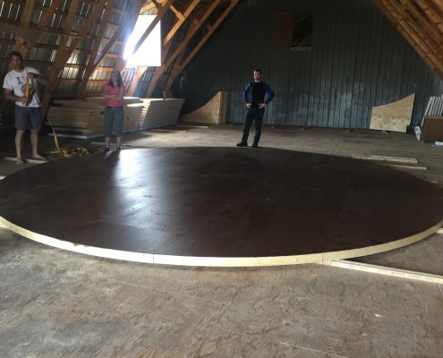 yurt base being assembled inside the groovy yurts facility