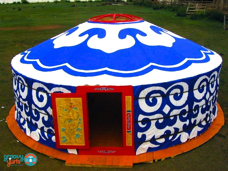 beautiful white and blue design on the exterior covering of a yurt