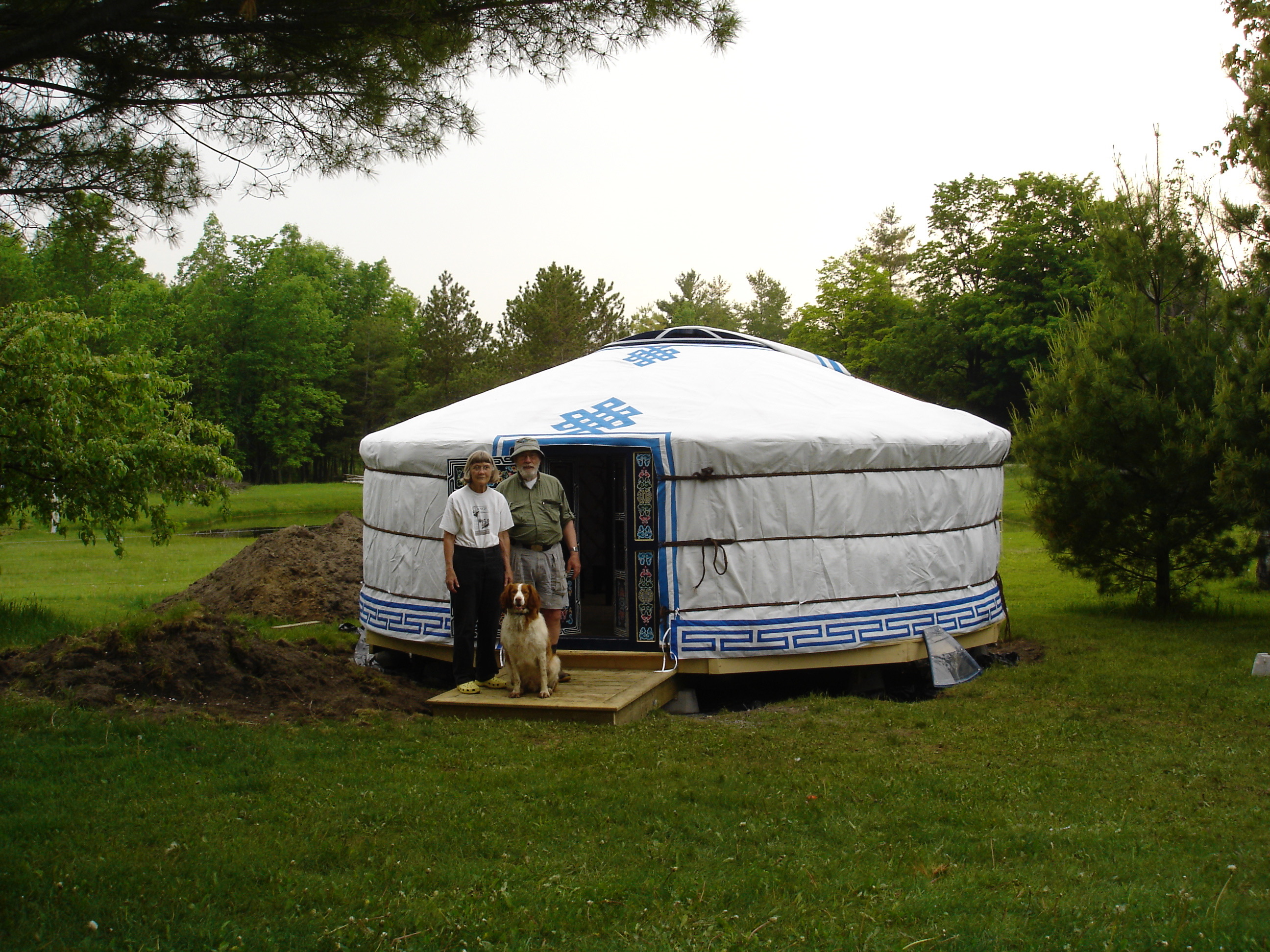 couple outside their Groovy Yurt