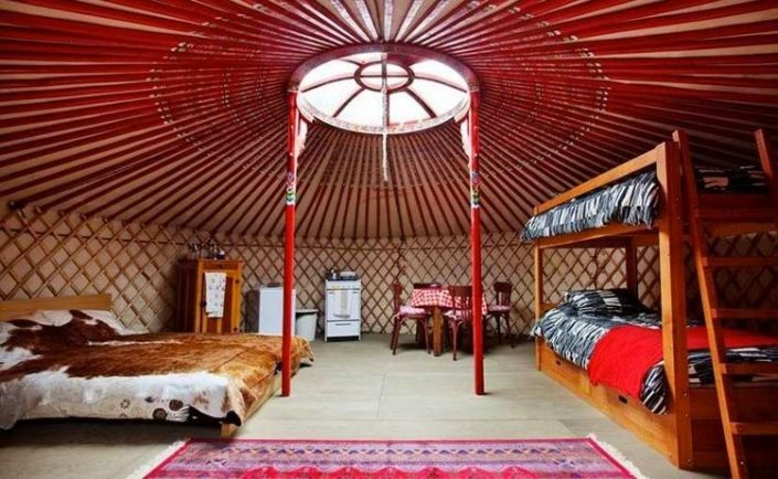 6 wall yurt built with a kitchen and 3 beds