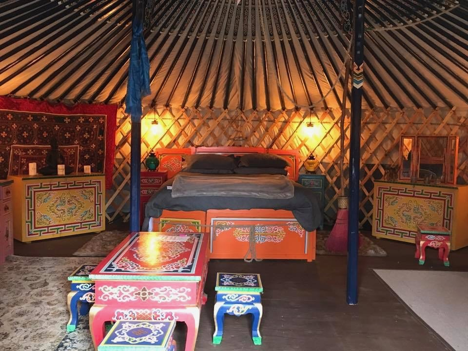 Yurt with a bedroom and furniture
