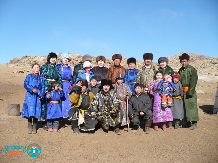 mongolian family posing together for a picture