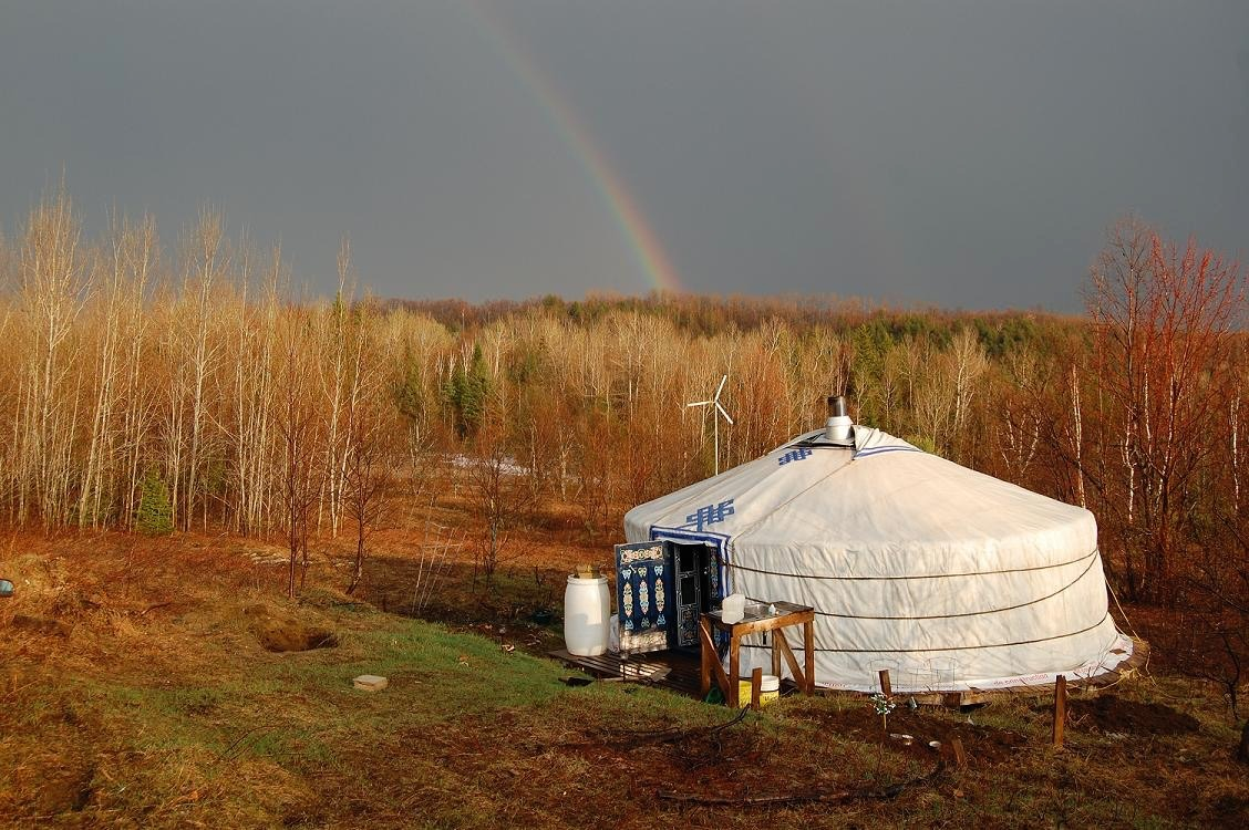 rainbow behind a large Mongolian Yurt