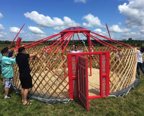 Setting up a GroovyLite Yurt at an outdoor festival