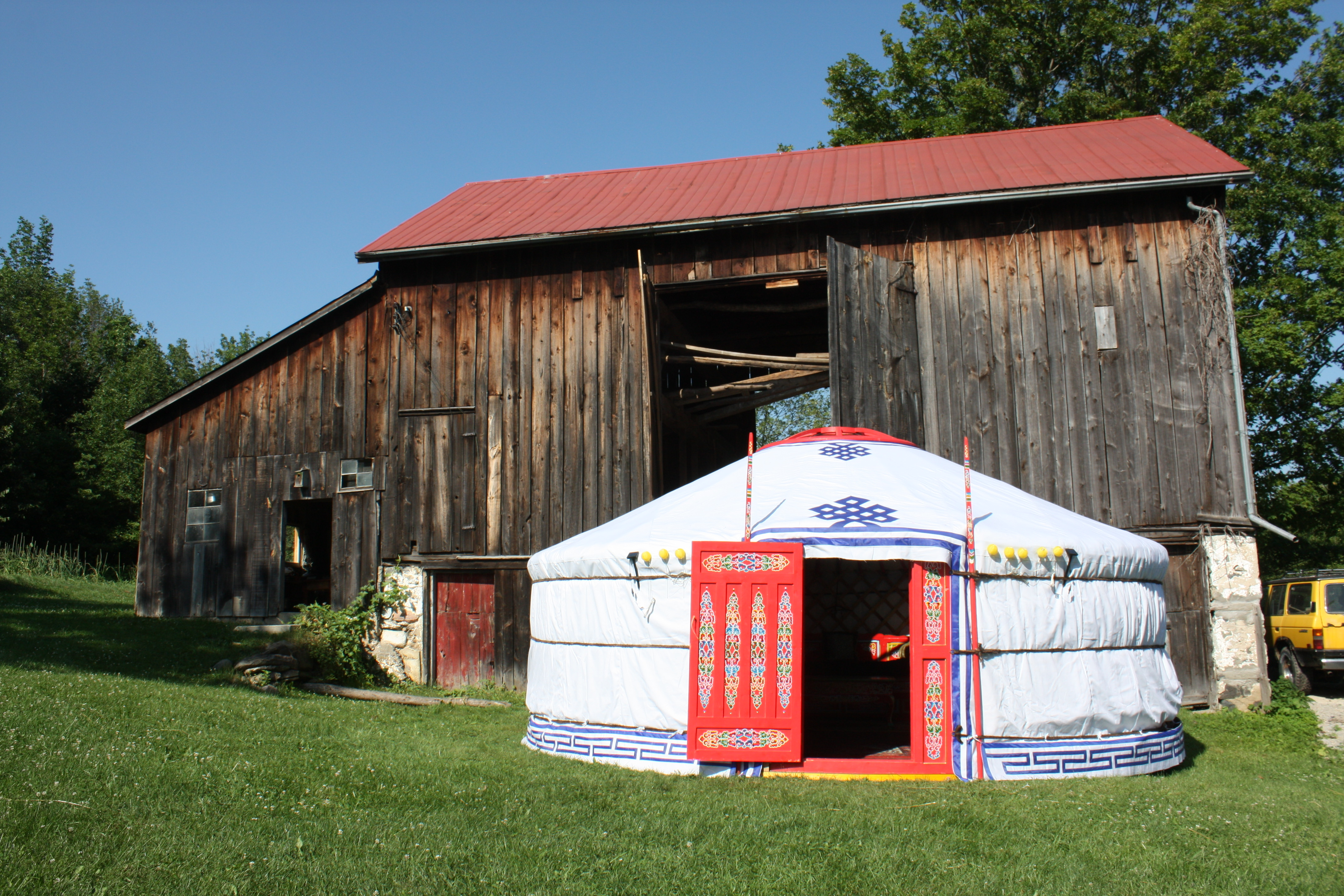 Super Yurt outside by barn