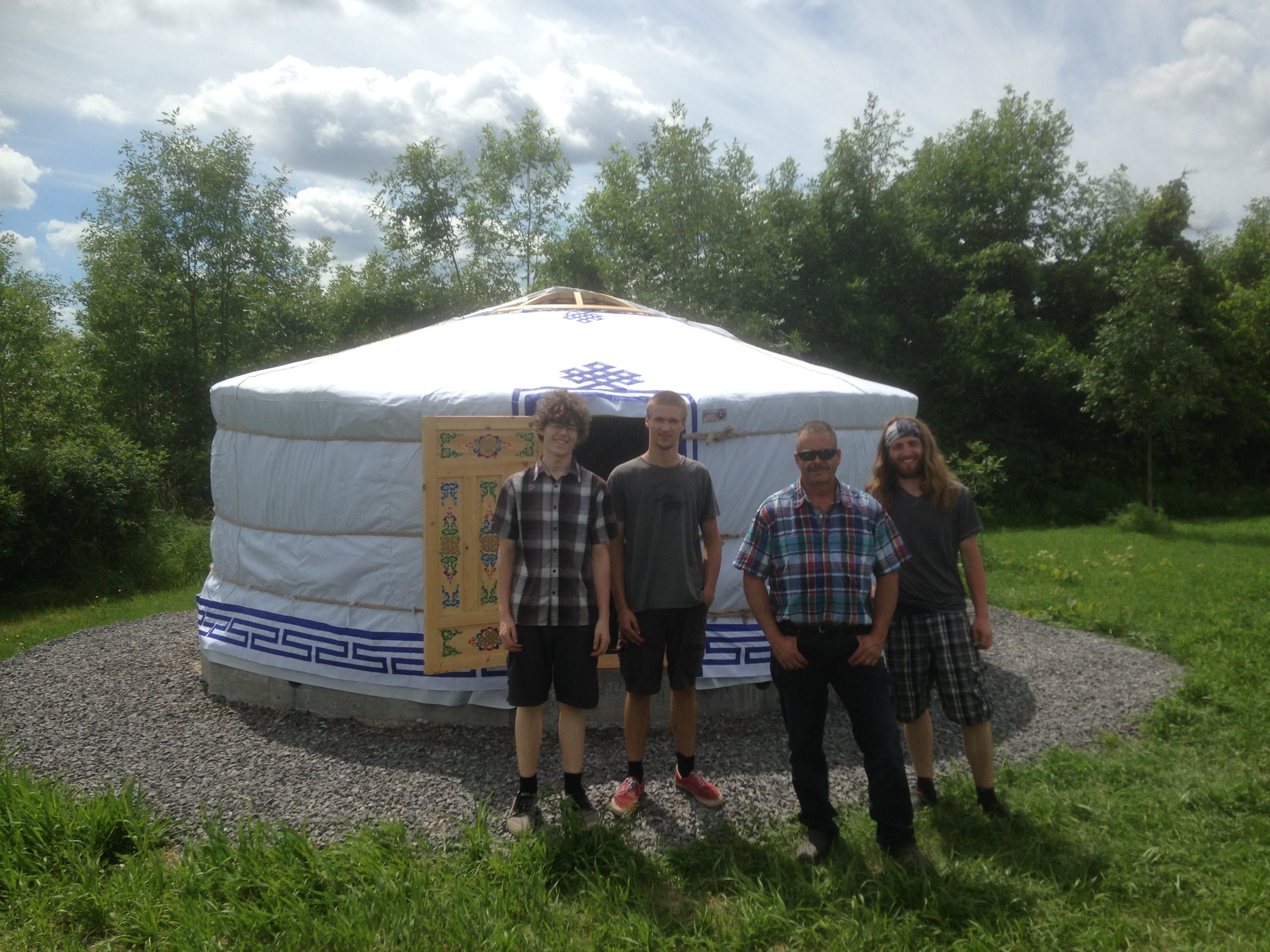 people outside of a Yurt