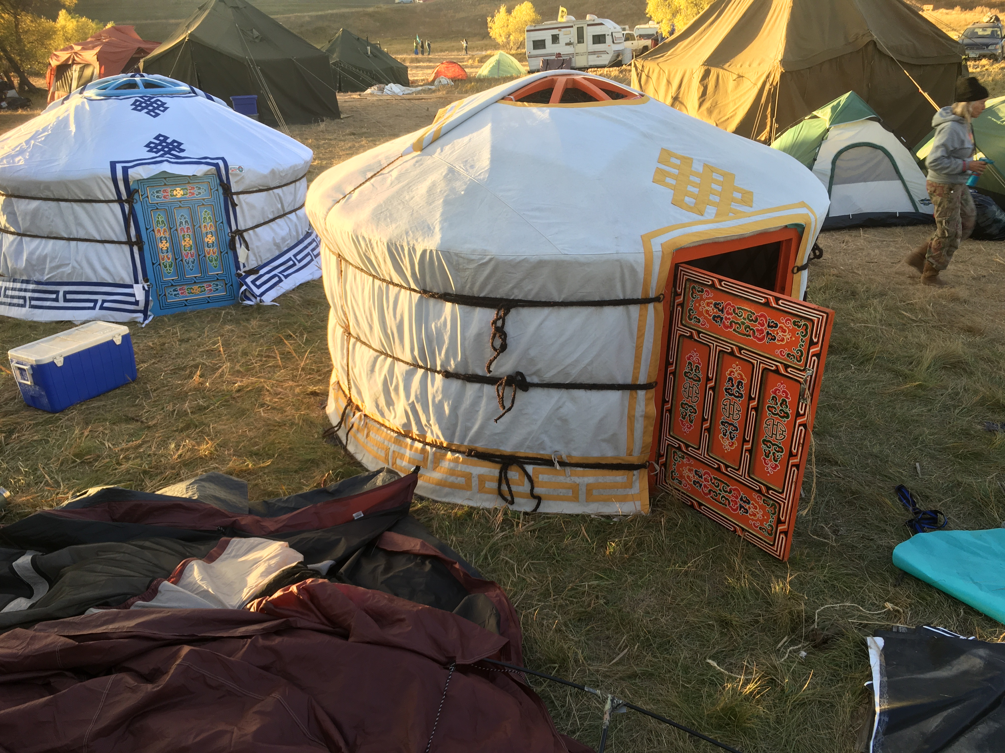 small yurts set up as tents outdoors