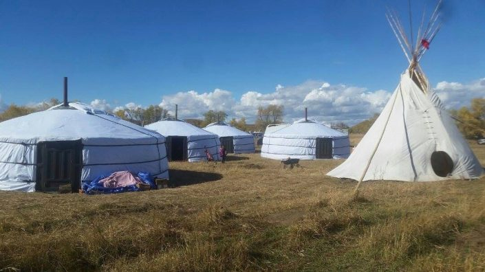 a field full of yurts