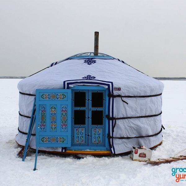 Outside white and blue Brezent covers for Yurts