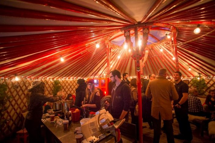 a dinner party inside of a yurt