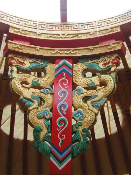 chinese structure with dragon design carved from wood