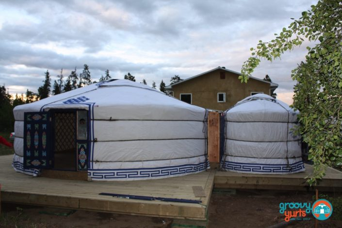 two connected yurts raised on a deck