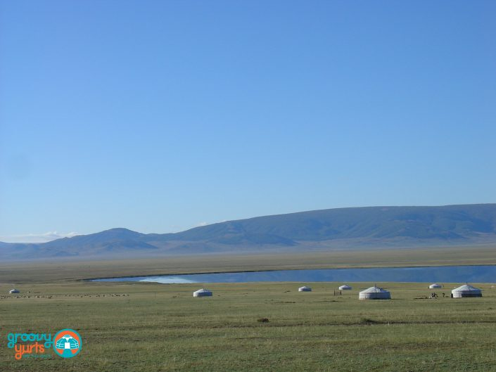 wide open valley with dispersed yurts