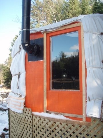 yurt window with a side stove pipe