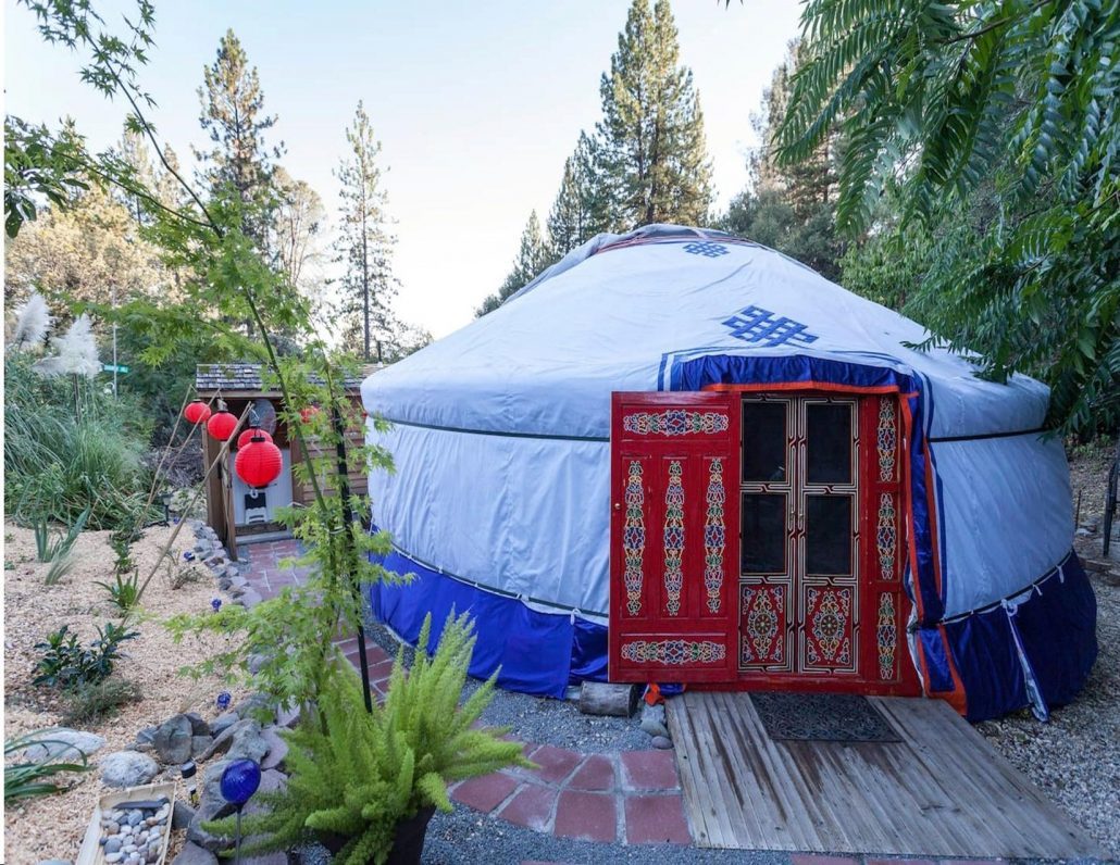 Cozy looking Yurt in backyard wooded garden