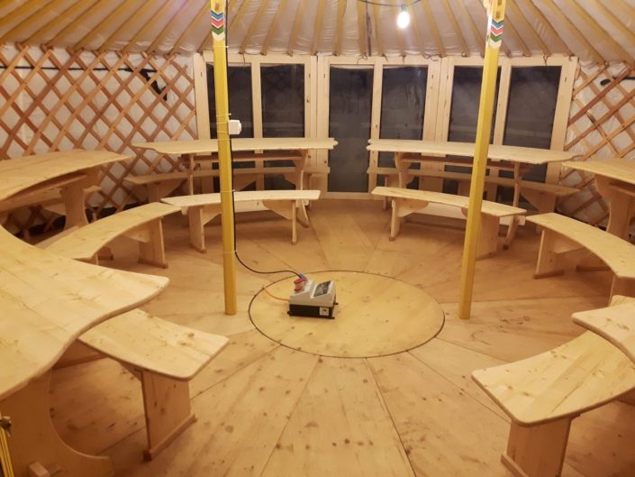 Fondue Yurt with picnic tables in switzerland