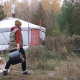 woman camping with her dog in a yurt