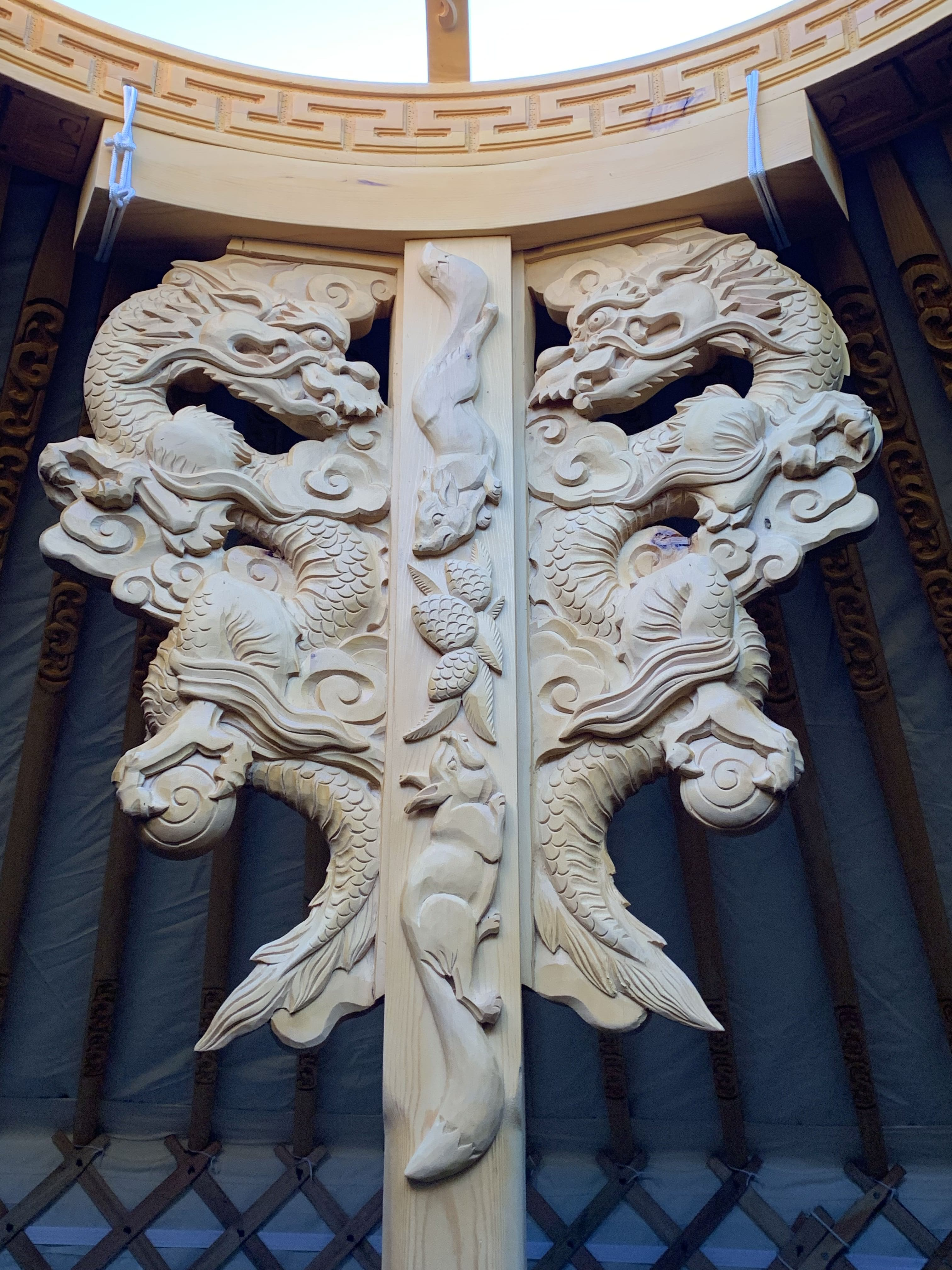 A beautifully-carved beam inside a GroovyYurt Yurt