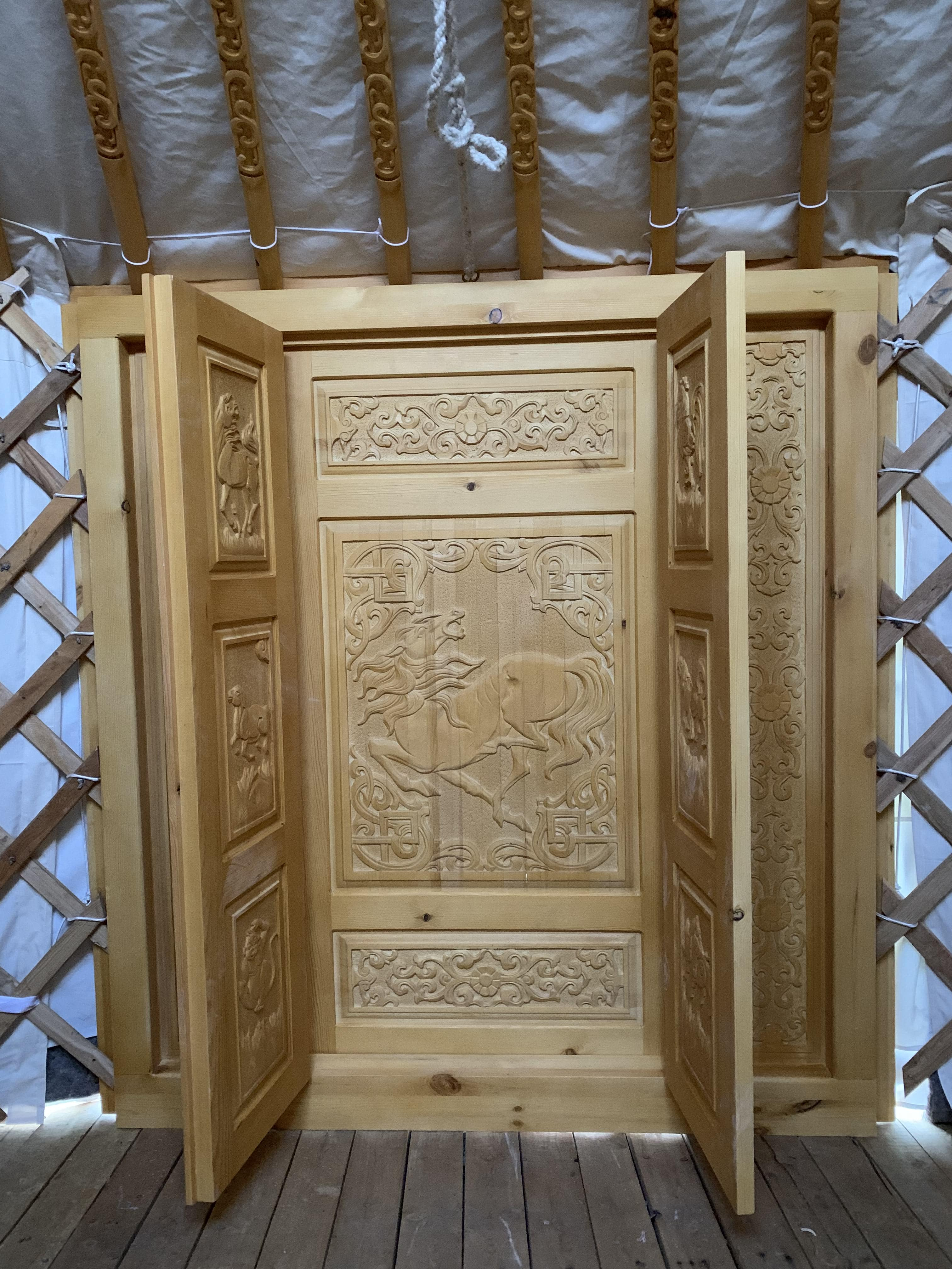 A beautifully carved wooden door
