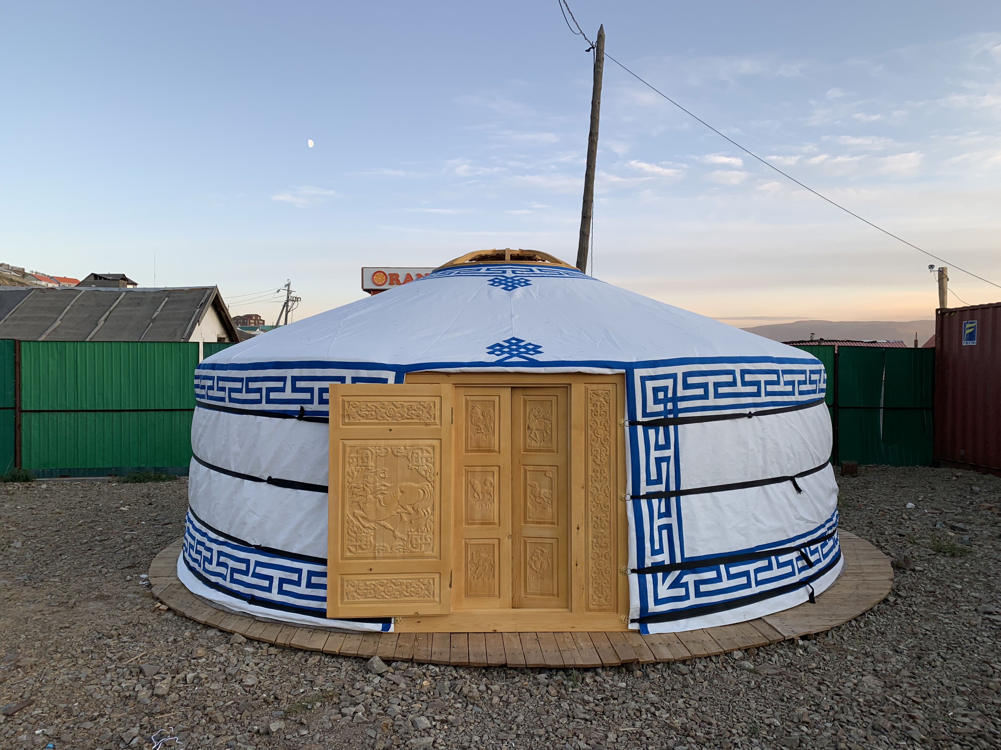 A beautiful yurt with a finely carved wooden door