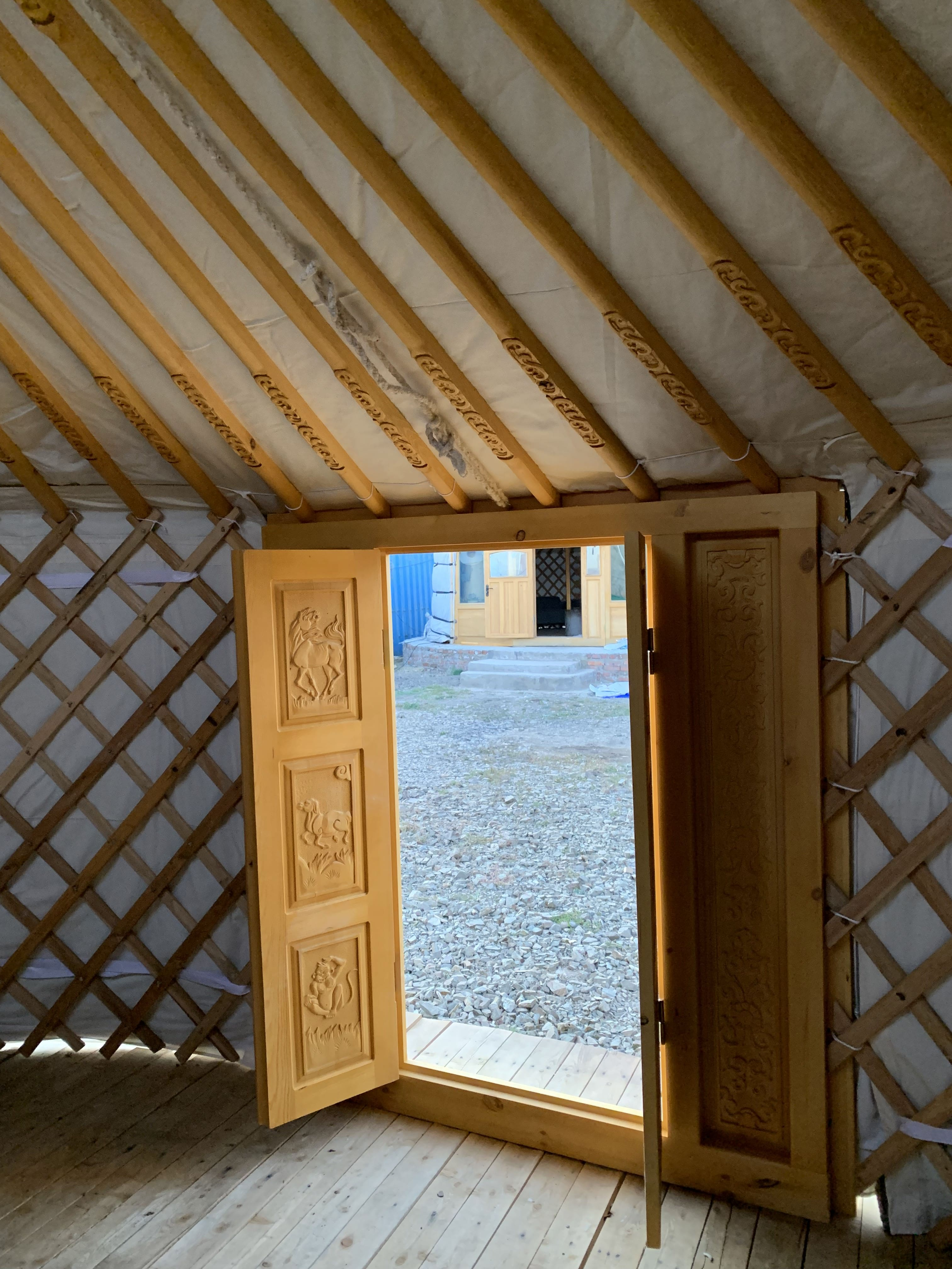 Inside a GroovyYurt Yurt looking out through the door