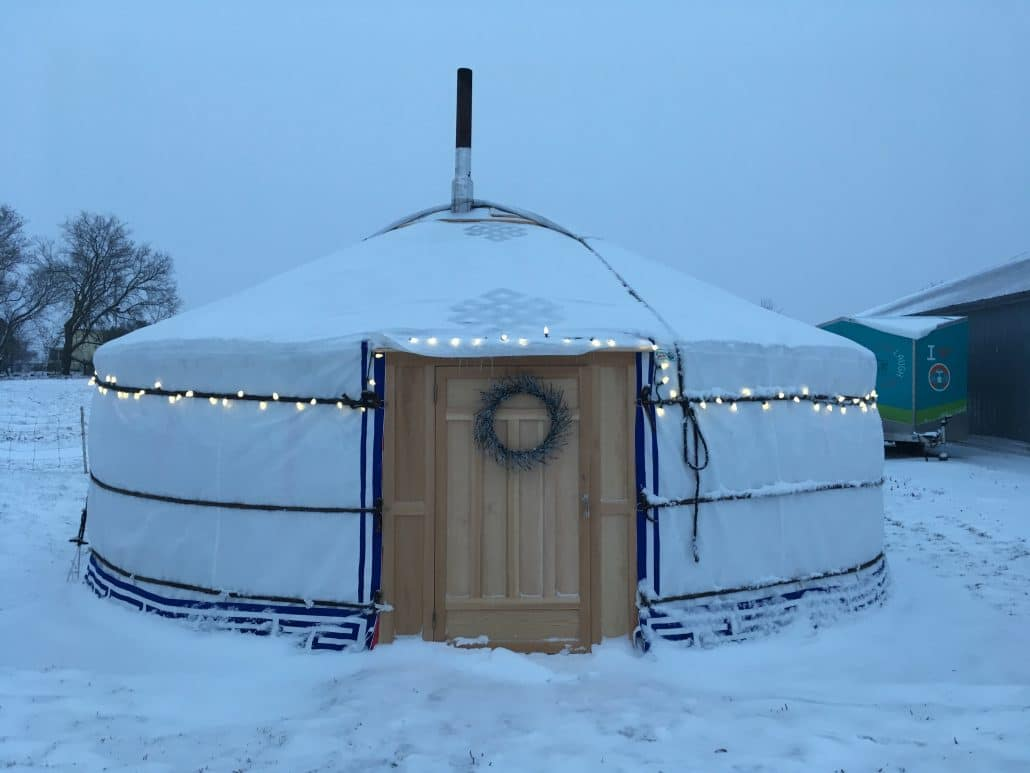 yurt in winter with christmas lights