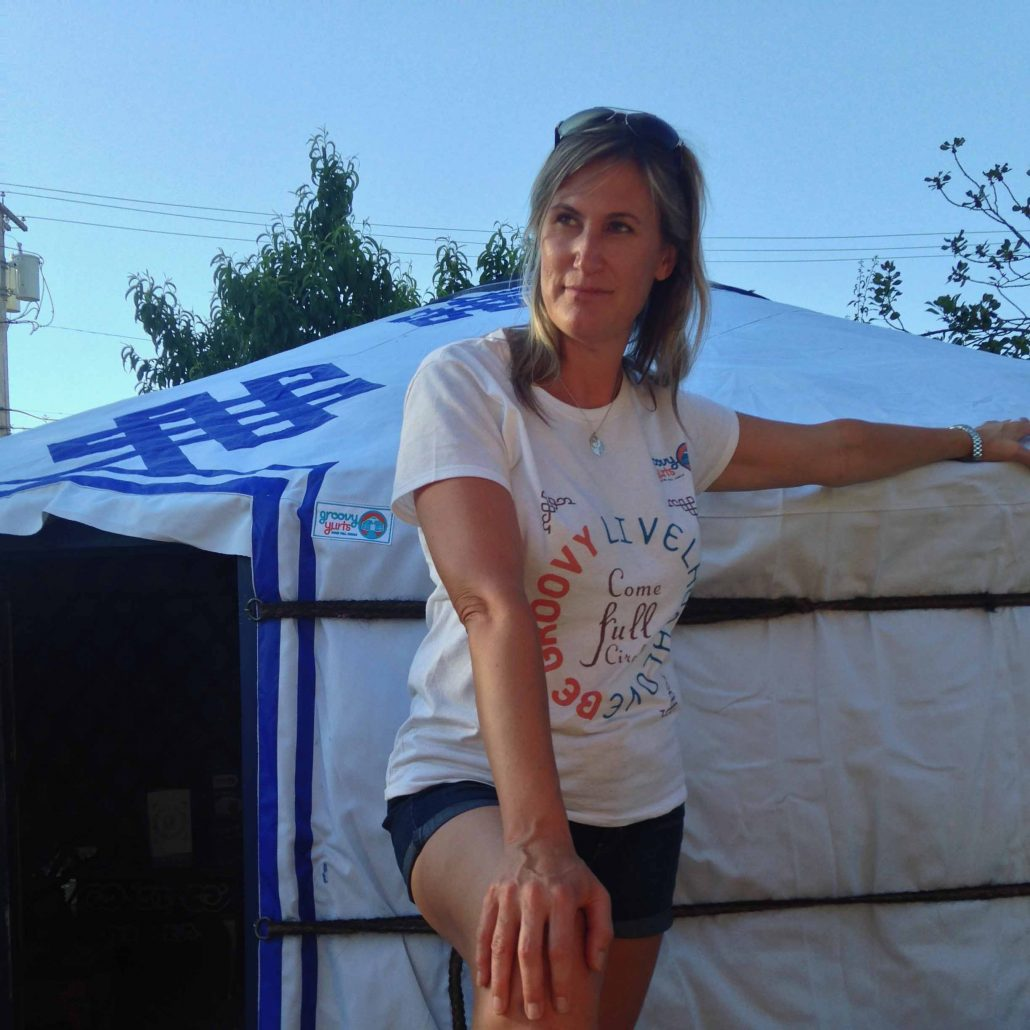 christine posing in front of a yurt