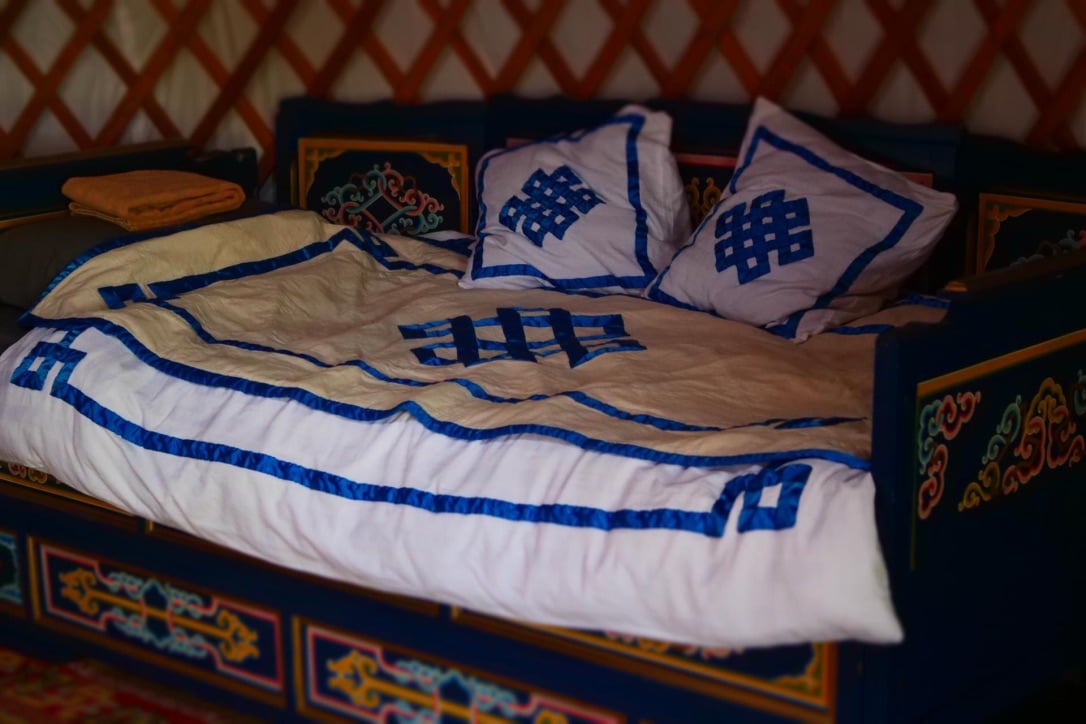 a couch that is transformed into a bed in a yurt
