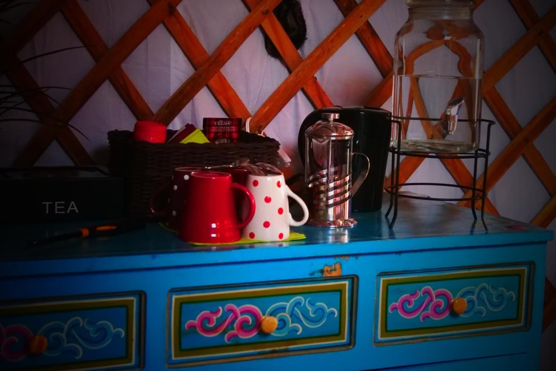 coffee station set up on a table in a yurt