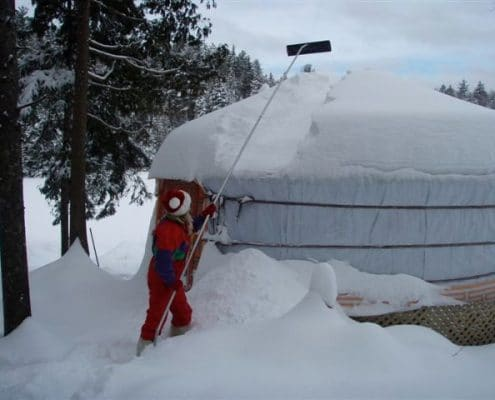 doing maintenance on a yurt in winter