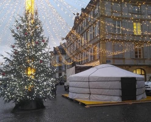 yurt under christmas decorations in a city square