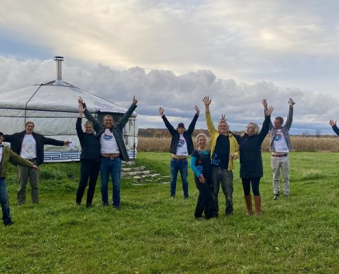 the groovy yurts team celebrating outdoors