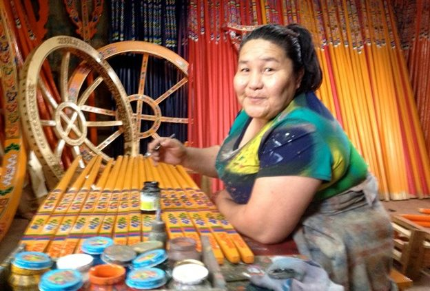 Mongolian woman making yurt decorations
