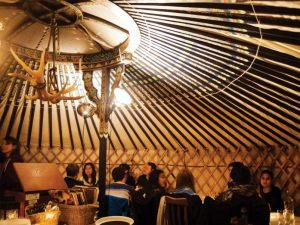 people dining in yurt restaurant patio