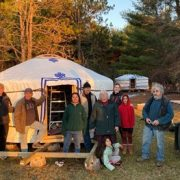 the groovy yurts team standing in front of an assembled yurt