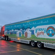 groovy yurts truck driving to a shipping facility ready to offload product