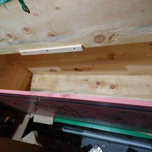 a long pink wooden chest