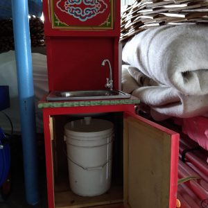 a groovy yurts red sink with bucket