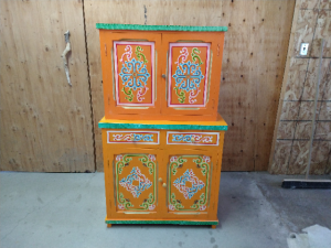 yellow painted drawer dresser with a unique design
